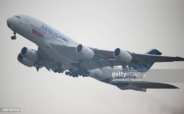 An Airbus A380 plane performs at the Airshow China 2014 in Zhuhai south China's Guangdong province on November 11 2014 Global aviation firms flocked...