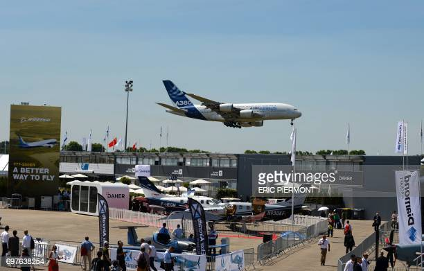 An Airbus A380 prepares to land after performing a flying display at Le Bourget airport on June 19 2017 on the opening day of the International Paris...