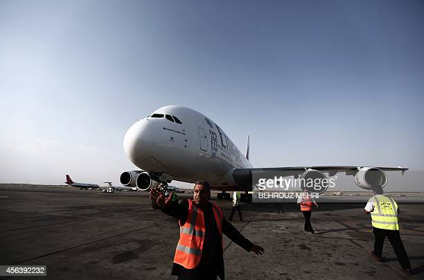 An Airbus A380800 airctaft of Emirates Airline sits on the tarmac after landing at Tehran's IKA airport on September 30 2014 Dubai's Emirates Airline...