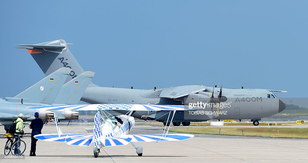 An Airbus A400M arrives at the International Aerospace Exhibition (ILA) in Schoenefeld on May 30, 2016. The Aerospace Exhibition at Schoenefeld Airport near Berlin takes place from June 1 till 4. / AFP / TOBIAS