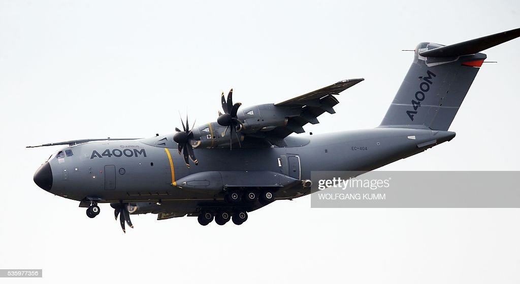 An Airbus A400M flies during the International Aerospace Exhibition (ILA) in Schoenefeld on May 31, 2016. The Aerospace Exhibition at Schoenefeld Airport near Berlin takes place from June 1 till 4. / AFP / dpa / Wolfgang Kumm / Germany OUT