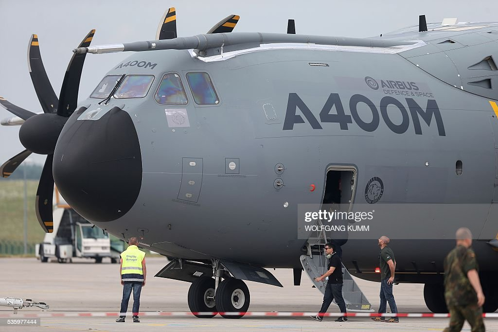An Airbus A400M is pictured during the International Aerospace Exhibition (ILA) in Schoenefeld on May 31, 2016. The Aerospace Exhibition at Schoenefeld Airport near Berlin takes place from June 1 till 4. / AFP / dpa / Wolfgang Kumm / Germany OUT