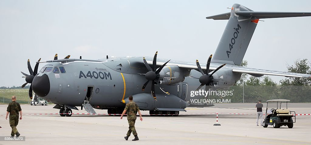 An Airbus A400M stands on the tarmac at the International Aerospace Exhibition (ILA) in Schoenefeld on May 31, 2016. The Aerospace Exhibition at Schoenefeld Airport near Berlin takes place from June 1 till 4. / AFP / dpa / Wolfgang Kumm / Germany OUT