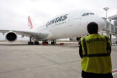 An Airbus is parked at the EADS factory before flying via Singapore to Sydney September 19 2008 in Toulouse France Quatas's first Airbus which was...