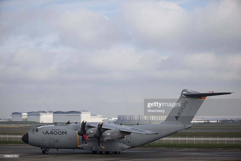 An Airbus Military A400MN stands on the runway in Colomiers, France, on Thursday, Jan. 17, 2013. Airbus SAS Chief Executive Officer Fabrice Bregier said he's sticking with a goal of flying the A350 jet mid-year and that it represents 'a lower risk approach' than the Boeing Co. 787 grounded by U.S. regulators yesterday. Photographer: Balint Porneczi/Bloomberg via Getty Images