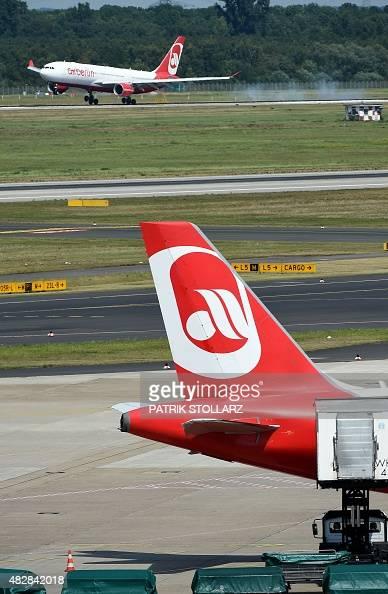 An Airbus of German airline 'Air Berlin' lands on the runway on August 3 2015 in Duesseldorf western Germany AFP PHOTO / PATRIK STOLLARZ