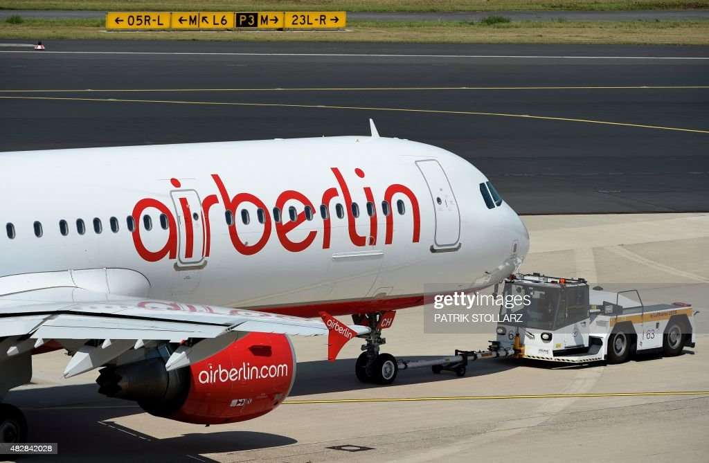 An Airbus of German airline 'Air Berlin' rolls on the runway on August 3 2015 in Duesseldorf western Germany AFP PHOTO / PATRIK STOLLARZ
