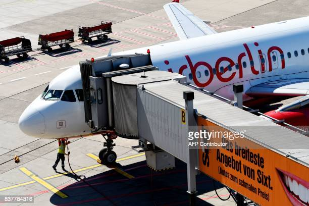 An Airbus of German airline 'Air Berlin' stands at the airport on August 23 2017 in Duesseldorf western Germany / AFP PHOTO / PATRIK STOLLARZ