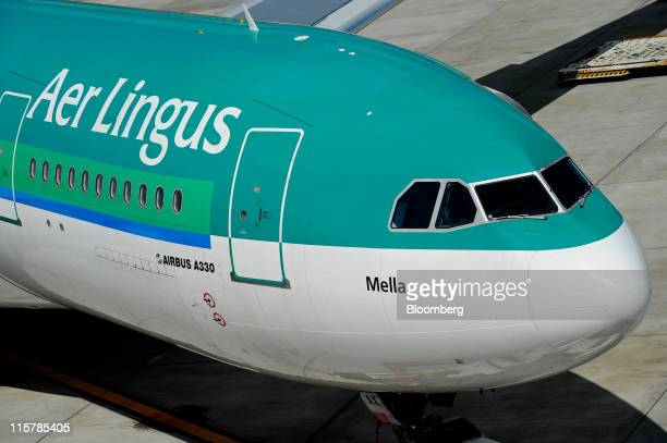 An Airbus SAS A330 aircraft operated by Aer Lingus Group Plc is maneuvered on the tarmac at Dublin Airport in Dublin Ireland on Thursday June 9 2011...