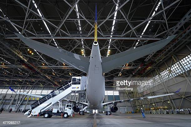 An Airbus SAS A330 aircraft operated by Skymark Airlines Inc stands in a hangar during a media preview at Haneda Airport in Tokyo Japan on Friday...