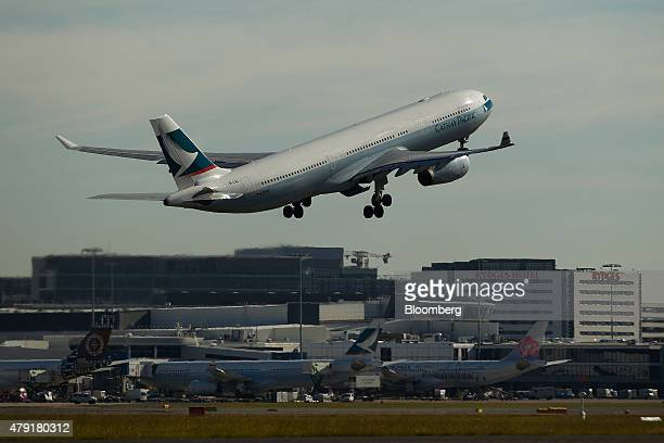 An Airbus SAS A330300 aircraft operated by Cathay Pacific Airways Ltd takes off at Sydney Airport in Sydney Australia on Monday June 22 2015...