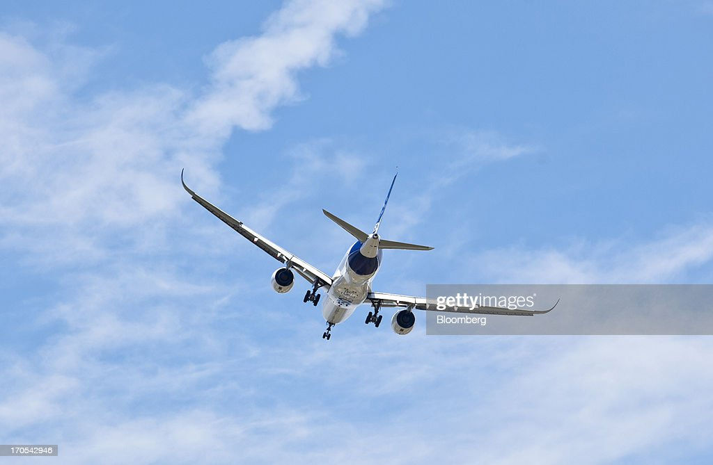 An Airbus SAS A350, produced by a unit of European Aeronautic, Defence & Space Co. (EADS), prepares to land following its first flight in Toulouse, France, on Friday, June 14, 2013. Airbus SAS's new A350 wide-body returned from its maiden flight after a four-hour airborne test of the long-range airliner, in a show of confidence that the jet can enter service in late 2014 and challenge Boeing Co. Photographer: Balint Porneczi/Bloomberg via Getty Images