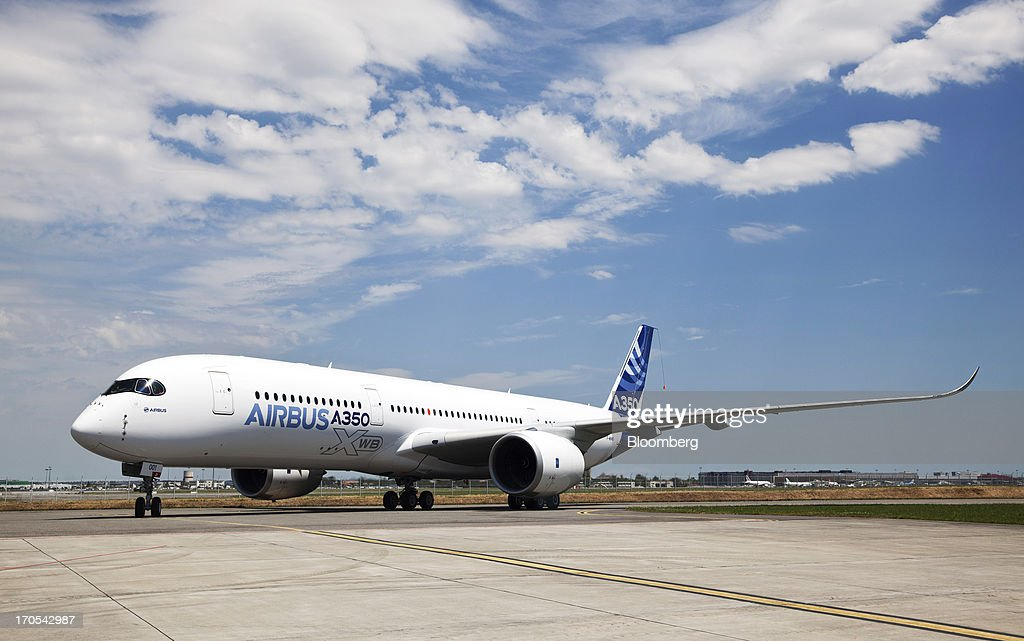 An Airbus SAS A350, produced by a unit of European Aeronautic, Defence & Space Co. (EADS), stands on the runway following its first flight in Toulouse, France, on Friday, June 14, 2013. Airbus SAS's new A350 wide-body returned from its maiden flight after a four-hour airborne test of the long-range airliner, in a show of confidence that the jet can enter service in late 2014 and challenge Boeing Co. Photographer: Balint Porneczi/Bloomberg via Getty Images