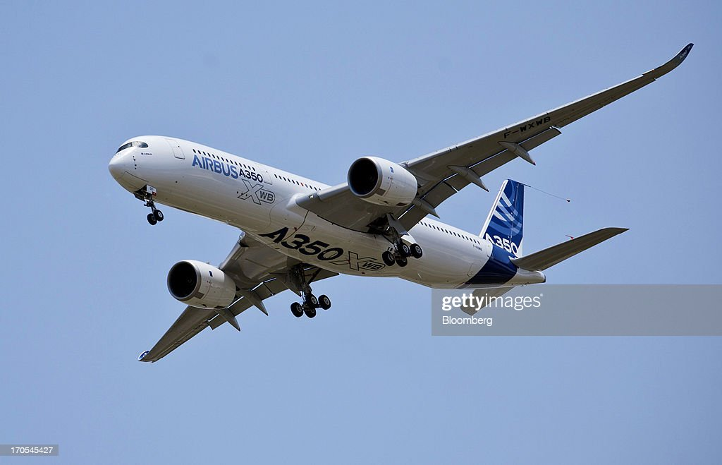 An Airbus SAS A350, produced by a unit of European Aeronautic, Defence & Space Co. (EADS), prepares to land following its first flight in Toulouse, France, on Friday, June 14, 2013. Airbus SAS's new A350 wide-body lifted off for its maiden voyage at 10:00 a.m. before a crowd of 12,000, in a show of confidence that the jet can enter service in late 2014 and challenge Boeing Co. Photographer: Balint Porneczi/Bloomberg via Getty Images