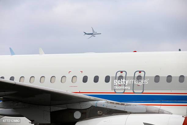 An Airbus SAS A350 XWB aircraft performs an aerial demonstration above an Airbus A320 on the opening day of the 51st International Paris Air Show in...