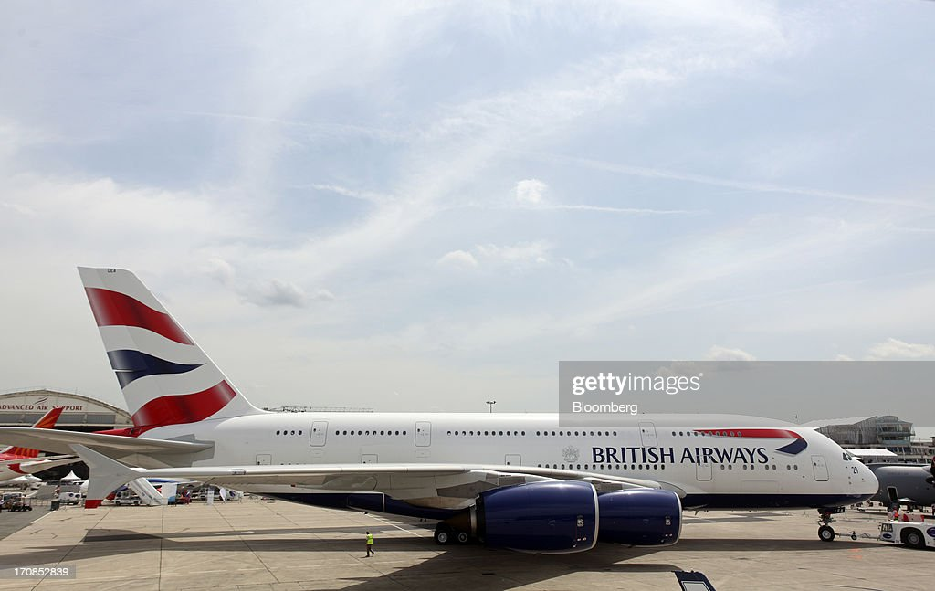 An Airbus SAS A380 aircraft, operated by British Airways, is maneuvered across the tarmac on the second day of the Paris Air Show in Paris, France, on Tuesday, June 18, 2013. The 50th International Paris Air Show is the world's largest aviation and space industry show, and takes place at Le Bourget airport June 17-23. Photographer: Balint Porneczi/Bloomberg via Getty Images