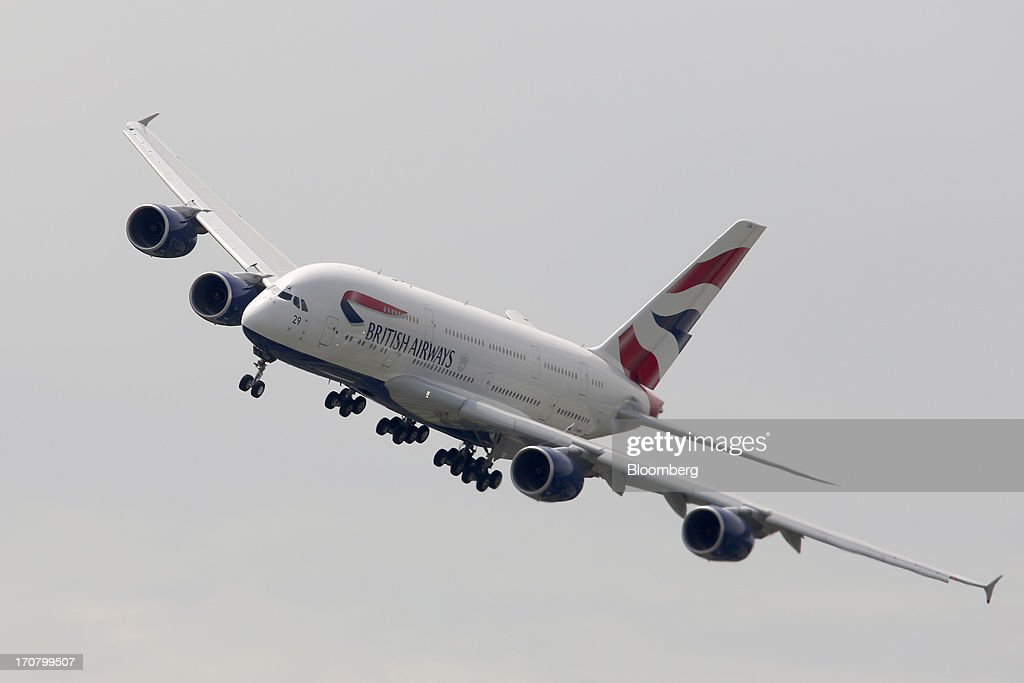 An Airbus SAS A380 aircraft operated by British Airways performs in a flying display on the second day of the Paris Air Show in Paris, France, on Tuesday, June 18, 2013. The 50th International Paris Air Show is the world's largest aviation and space industry show, and takes place at Le Bourget airport June 17-23. Photographer: Chris Ratcliffe/Bloomberg via Getty Images