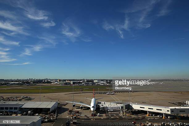 An Airbus SAS A380 aircraft operated by Qantas Airways Ltd stand docked at the International terminal at Sydney Airport in Sydney Australia on Monday...