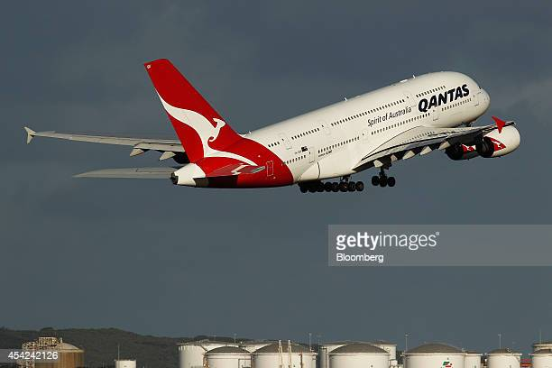 An Airbus SAS A380 aircraft operated by Qantas Airways Ltd takes off at Sydney Airport in Sydney Australia on Wednesday Aug 27 2014 Qantas...