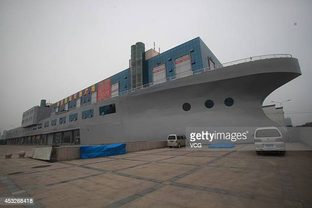 An aircraft carrier shaped building with the covered area of 48818 square meters the length of 169 meters and the width of 50 meters is seen on...