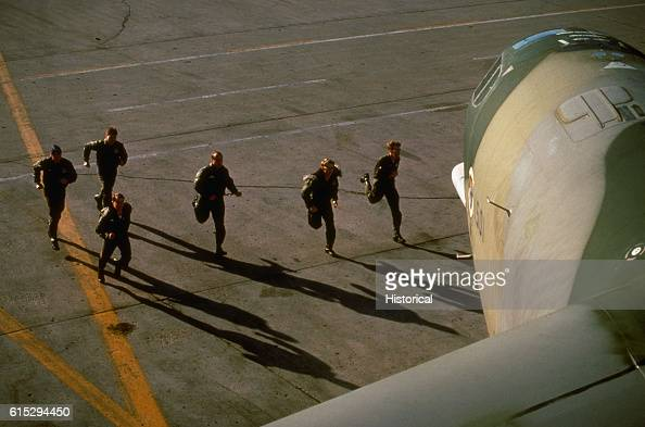 An aircraft crew runs toward a B52H Stratofortress aircraft during a flight alert Grand Forks Air Force Base North Dakota April 1981 | Location Grand...
