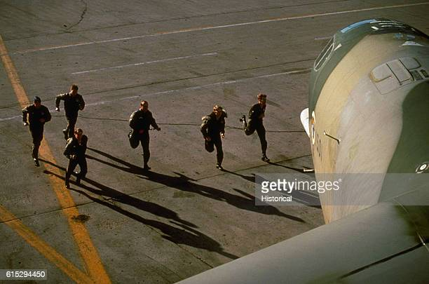 An aircraft crew runs toward a B52H Stratofortress aircraft during a flight alert Grand Forks Air Force Base North Dakota April 1981 | Location Grand...