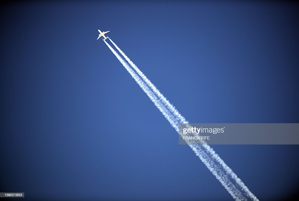 An aircraft flies over the French Alps on December 9, 2012 in Val d'Isere'.