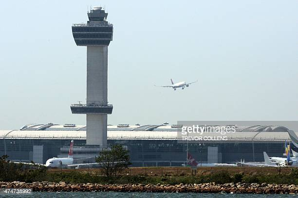 An aircraft flies past the control tower as it prepares to land at New York's John F Kennedy Airport May 25 2015 US warplanes were scrambled to...