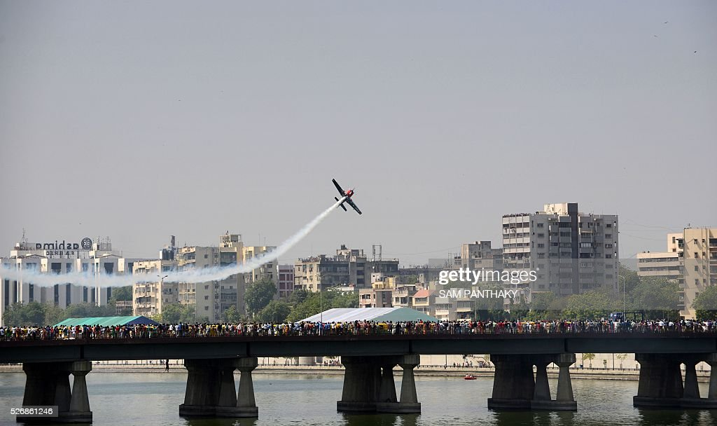 An aircraft from Britain's Global Stars Aerobatic team performs a display routine on the final day of a three day airshow in Ahmedabad on May 1, 2016. / AFP / SAM