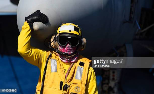 An aircraft handler looks on during flight operations on July 14 2017 in Townsville Australia USS Ronald Reagan is a 1092 foot aircraft carrier which...