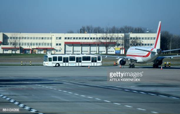 An aircraft is parked on the tarmac on December 1 2017 at the Liszt Ferenc international Airport in the Hungarian capital Budapest / AFP PHOTO /...