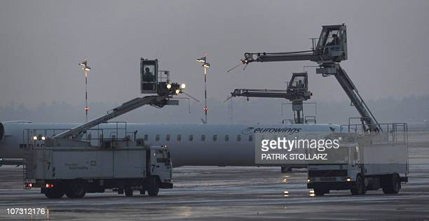An aircraft of the airline 'eurowings' is deiced at Duesseldorf International Airport on December 3 2010 in Duesseldorf Germany Heavy snowfalls...