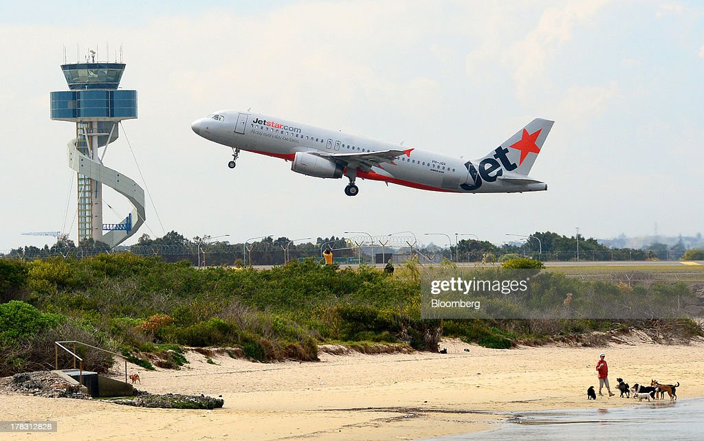 An aircraft operated by Jetstar Airways, the budget arm of Qantas Airways Ltd., takes off from Sydney Airport in Sydney, Australia, on Thursday, Aug. 29, 2013. Qantas, Australia's largest carrier, doubled its profits and beat analyst estimates as a tie-up with Emirates helped rein in long-haul losses. Its shares rose the most in a year. Photographer: Jeremy Piper/Bloomberg via Getty Images