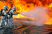 July 30, 2010 09/14/2009 An aircraft rescue firefighting team with the U.S. Marine Corps, attempts to spray out a fuel fire during training. The heat from the flames can reach 1,300 degrees.