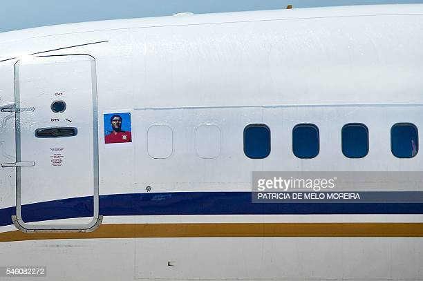 An aircraft sporting an image of former football player the late Eusebio da Silva Ferreir arrives with Portugal's national football team at Lisbon...