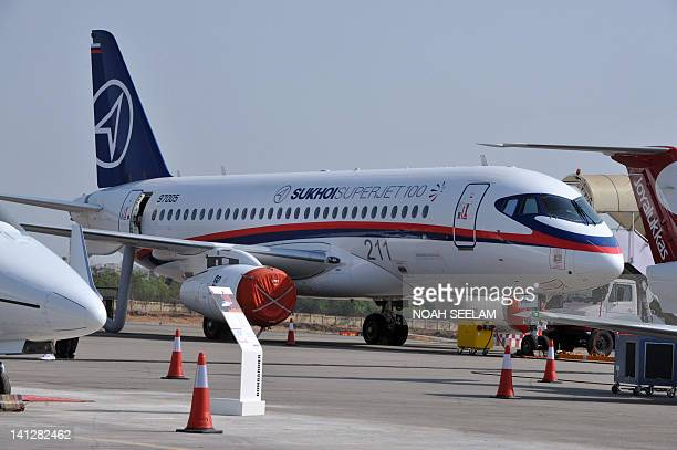 An aircraft Sukhoi Superjet 100 is pictured on static display on the opening day of the inaguration of the India Aviation2012 show at Begumpet...