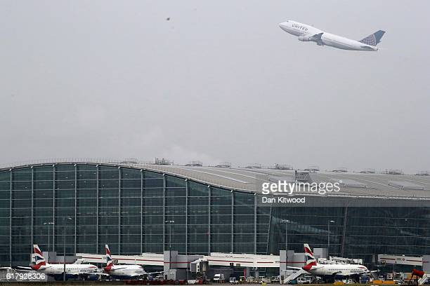 An aircraft takes of over Heathrow's Terminal 5 on October 25 2016 in London England At a cabinet committee meeting today the government approved a...