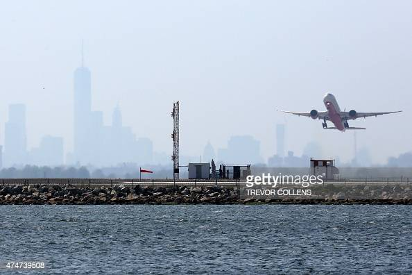 An aircraft takes off from New York's John F Kennedy Airport against a hazy backdrop of the city skyline May 25 after US warplanes were scrambled to...