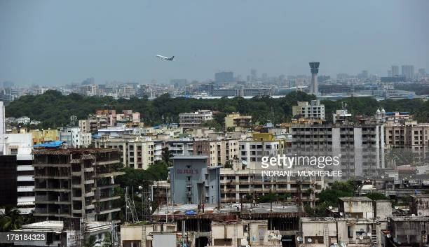 An aircraft takes off from the city airport in Mambai on August 20 2013 The infrastructure of Mumbai the financial capital of India and an oasis for...