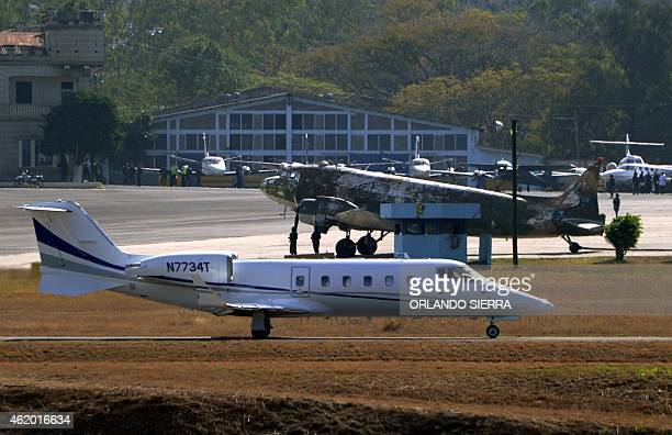 An aircraft with personnel of the US Drug Enforcement Administration escorting Honduran alleged drug traffickers Jose Inocente Valle his wife Marlen...