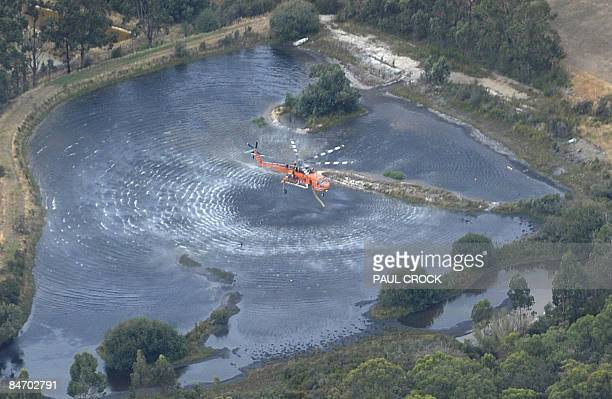 An aircrane firefighting aircraft collects a load of water to fight the Bunyip Ridge wildfire some 100km east of Melbourne on February 9 2009...