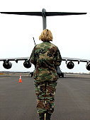 February 3, 2008 - An airfield manager with the 36th ContinGENcy Response Group, Andersen Air Force Base, Guam, greets an arriving C-17 Globemaster III at the Kona International Airport, Kona, Hawaii,