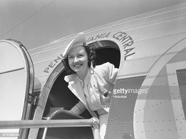 An airline hostess in the doorway of a Pennsylvania Central aircraft at the National Airport in Washington DC July 1941