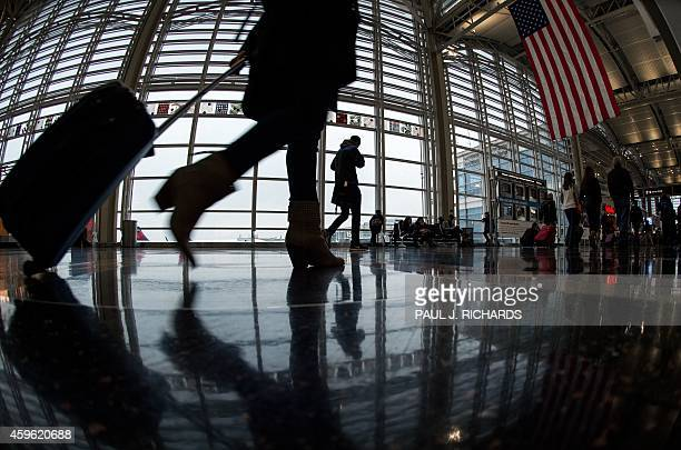 An airline traveler at Ronald Reagan National Airport walks to a Transportation Security Administration security checkpoint prior to traveling on...