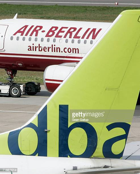 An airliner of German discount airline Air Berlin passes a plane of competitor DBA August 17 2006 at Tegel Airport in Berlin Germany Air Berlin head...
