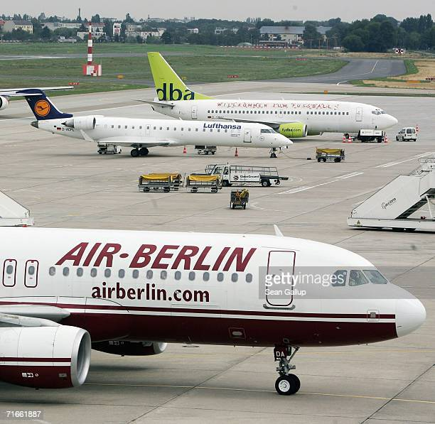 An airliner of German discount airlines Air Berlin passes planes of Lufthansa and DBA August 17 2006 at Tegel Airport in Berlin Germany Air Berlin...