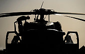 Camp Bastion, Afghanistan, June 25, 2009 - An Airman conducts a preflight inspection of an HH-60G Pave Hawk.