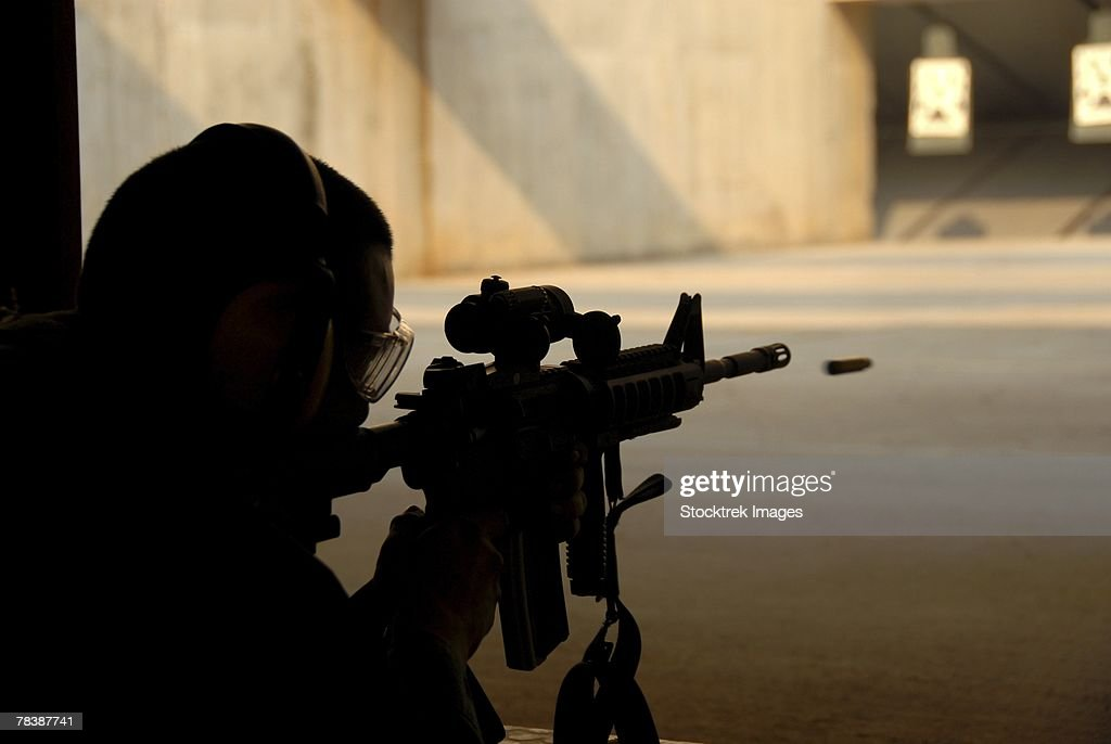 An airman tests his skills at a shooting range.