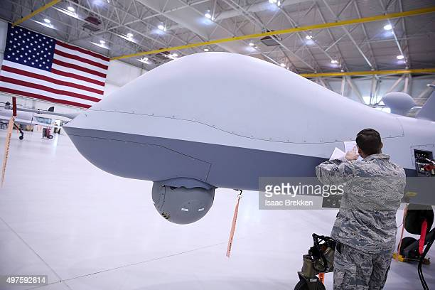 An airman works on an MQ9 Reaper remotely piloted aircraft in a hanger at Creech Air Force Base on November 17 2015 in Indian Springs Nevada The...