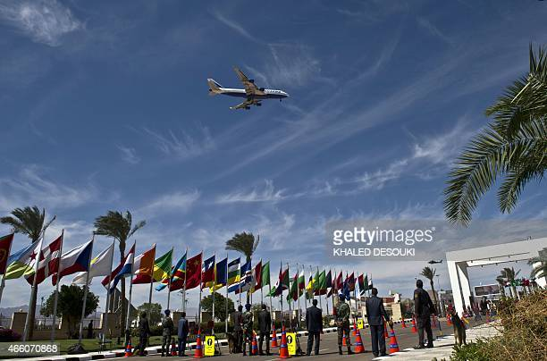 An airplane arrives at Sharm elSheikh airport near the congress hall in the Red Sea resort on March 13 as officials arrive for the Egypt Economic...